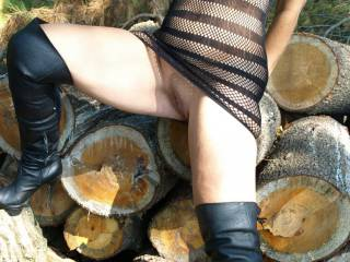 Hubby caught me dressing like a naughty girl and made me go to the woodpile. He said I needed to be taught a lesson and made me take the dress off. After giving me a good lickin',  he took out a big stick and thrust it upon me.  Now, did I deserve that?