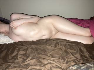 A photo of me laying down nude on my side