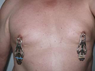 ooooo. that hurtz! umm... i wanna' smush those nips so i can get 'em pierced! yah! good idea?