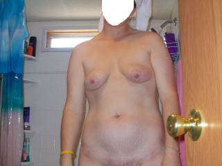 Stepping out of the shower. Sorry, she doesn't want to have her face reviled.