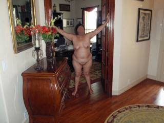 Totally nude and exposed in the office doorway and in full view of our glass front door!  If someone had come to knock on the door...they would have gotten a great show!