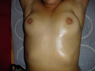 here a pic of my wifes tits. yummy