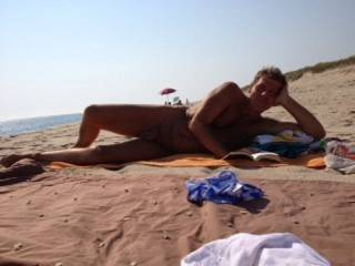 A few years back sunning  on the nude beach.  with the shadows if it was not for my bathing suit laying in the foreground it is hard to tell I am naked.Not real graphic but i like the shot do you?